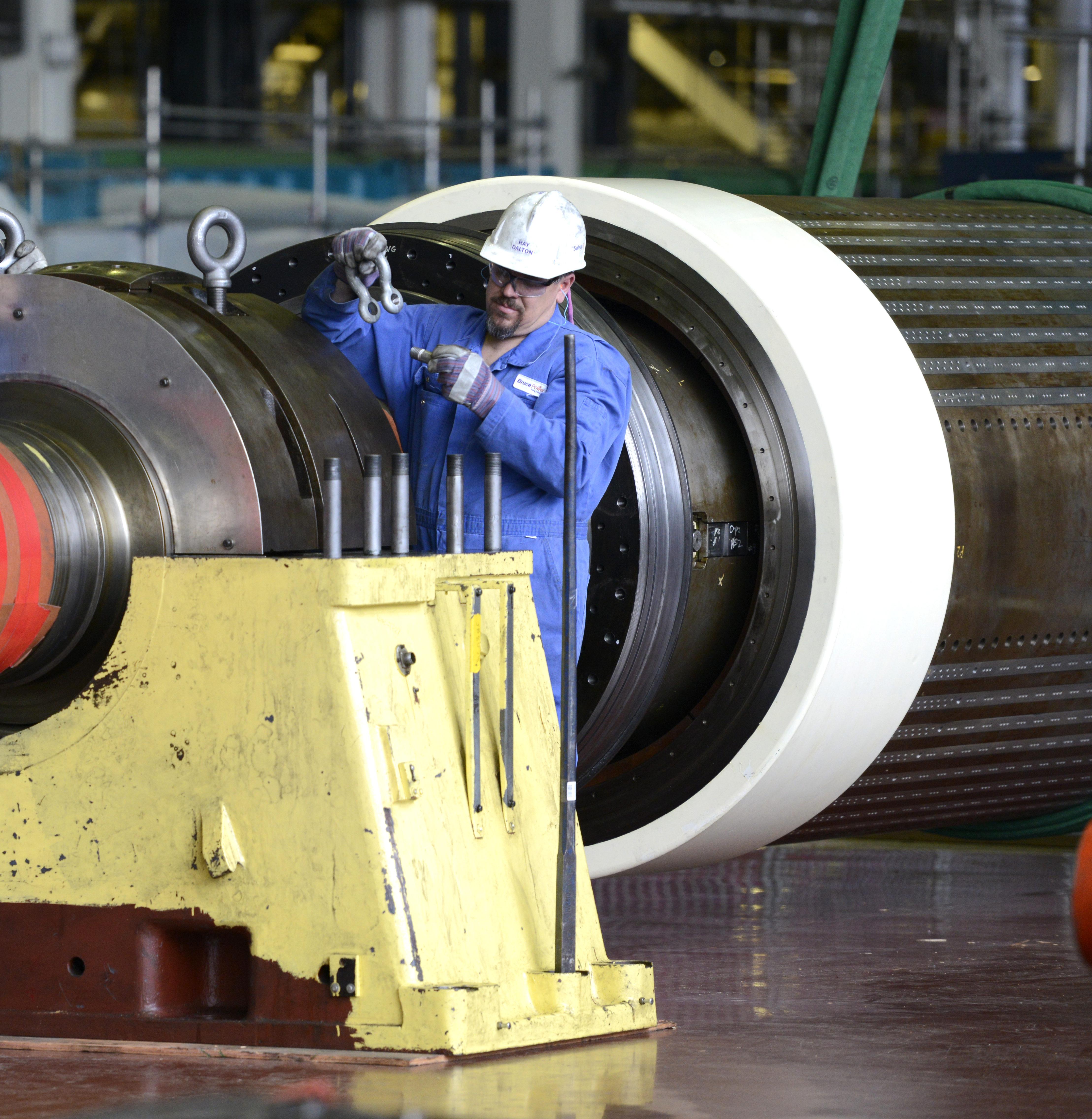 Employee repairs turbine