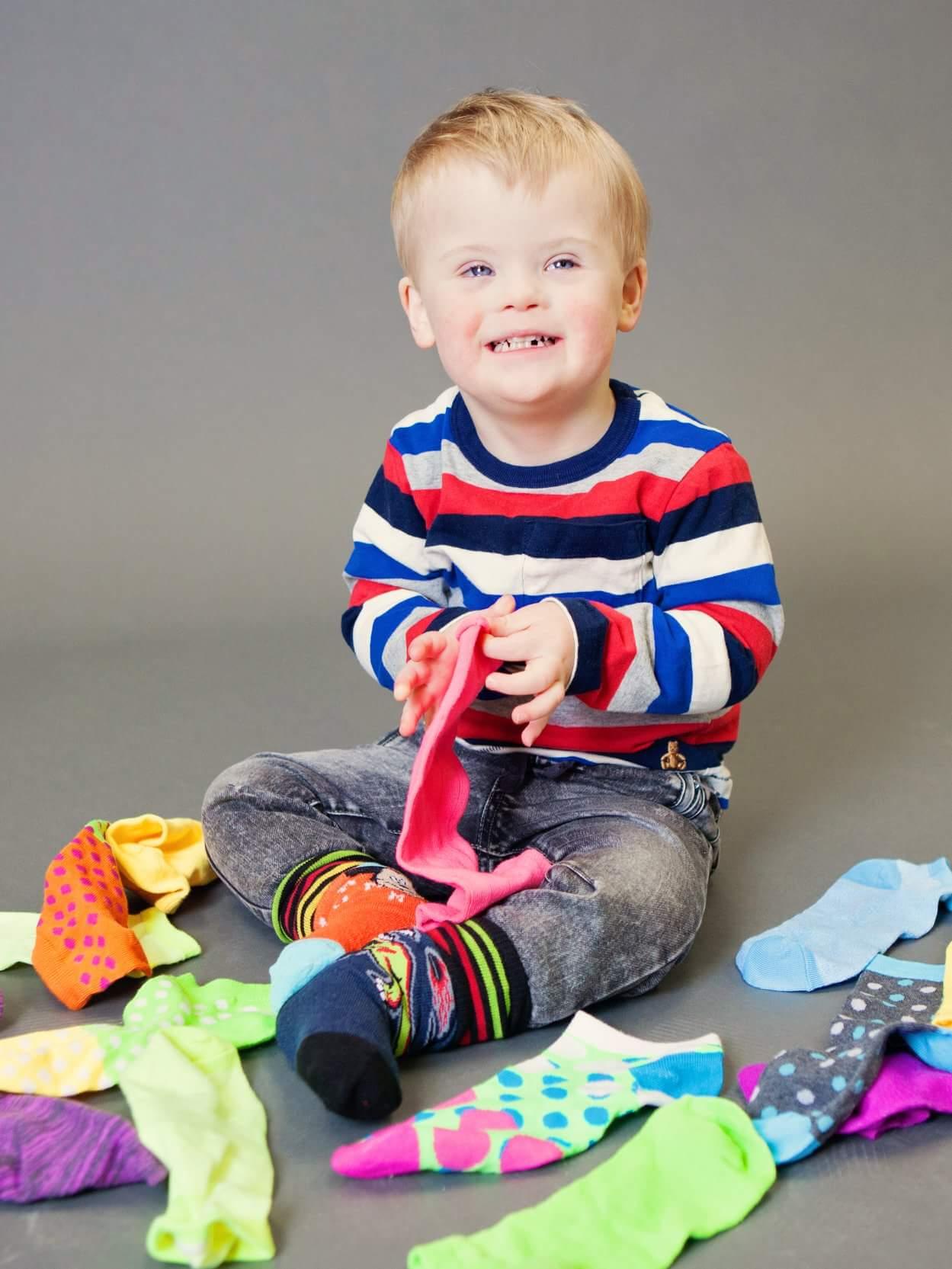 Logan celebrates Lot of Socks