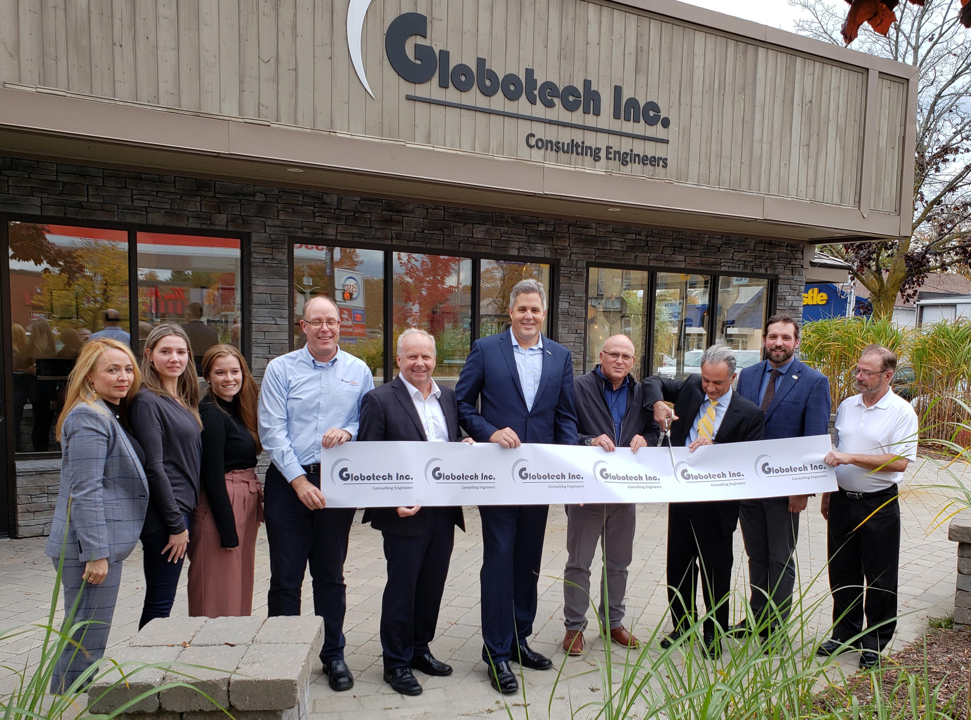 Dignitaries cut ribbon at Globotech Inc. office