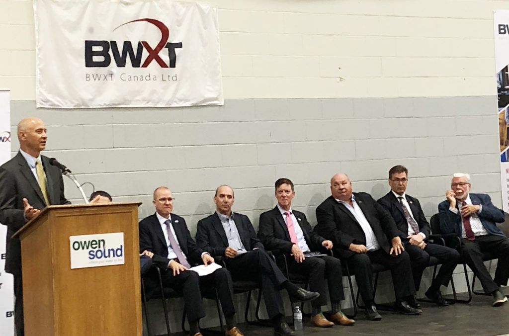 Mike Rencheck with dignitaries at BWXT announcement