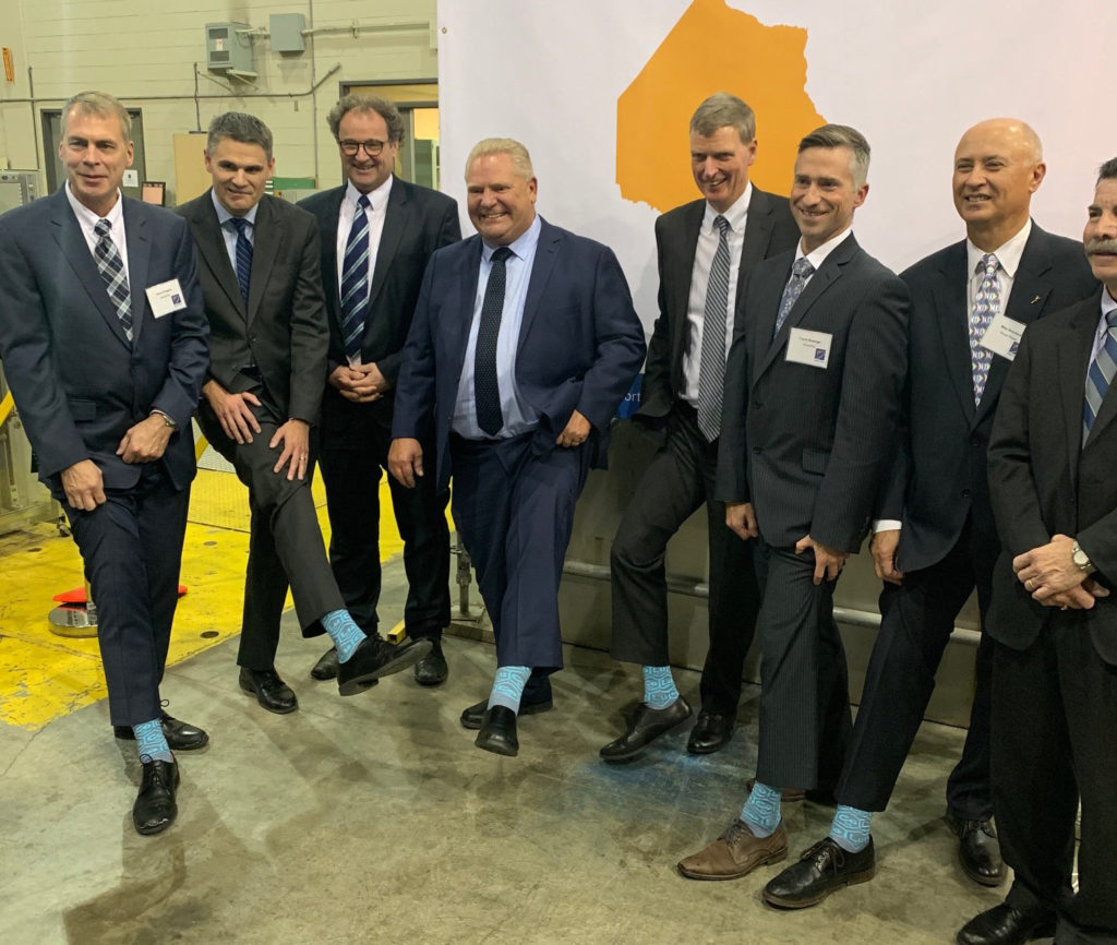 Premier Doug Ford and dignitaries show off Cobalt-60 socks