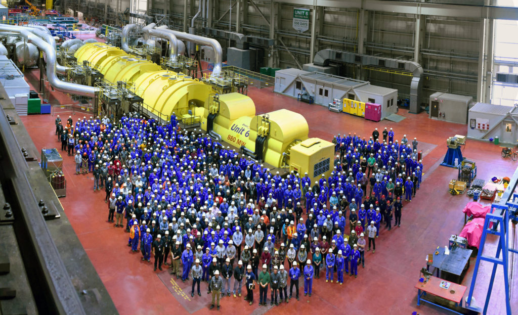Employees at Unit 6 turbine hall