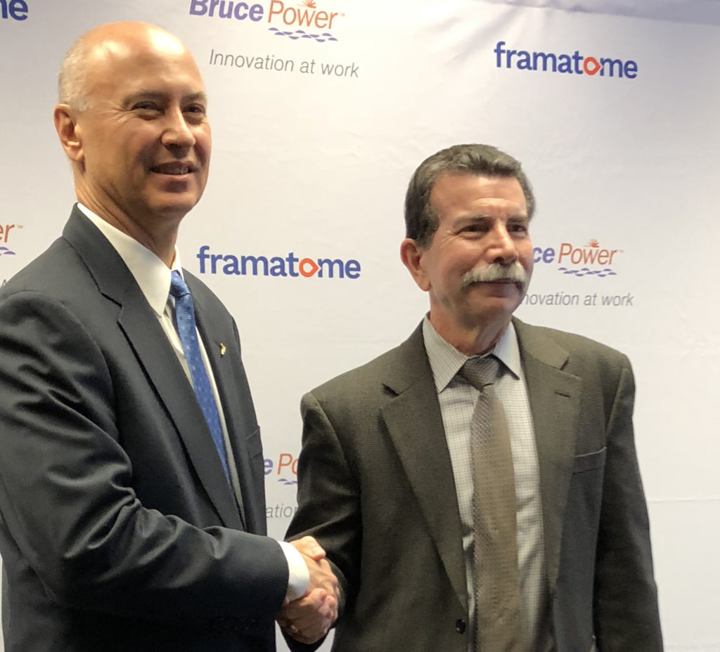Mike Rencheck and Gary Mignogna shake hands