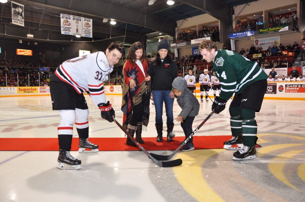 Saugeen Ojibway Nation youth drop puck at Owen Sound Attack game