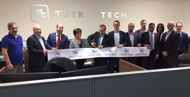 Dignitaries cut ribbon at Tetra Tech office