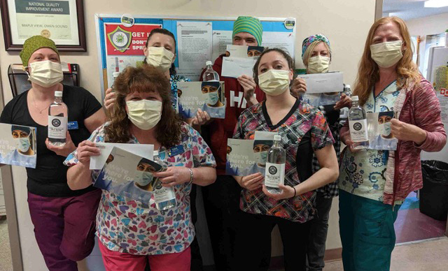Long-term Care staff with hand sanitizer from Bruce Power