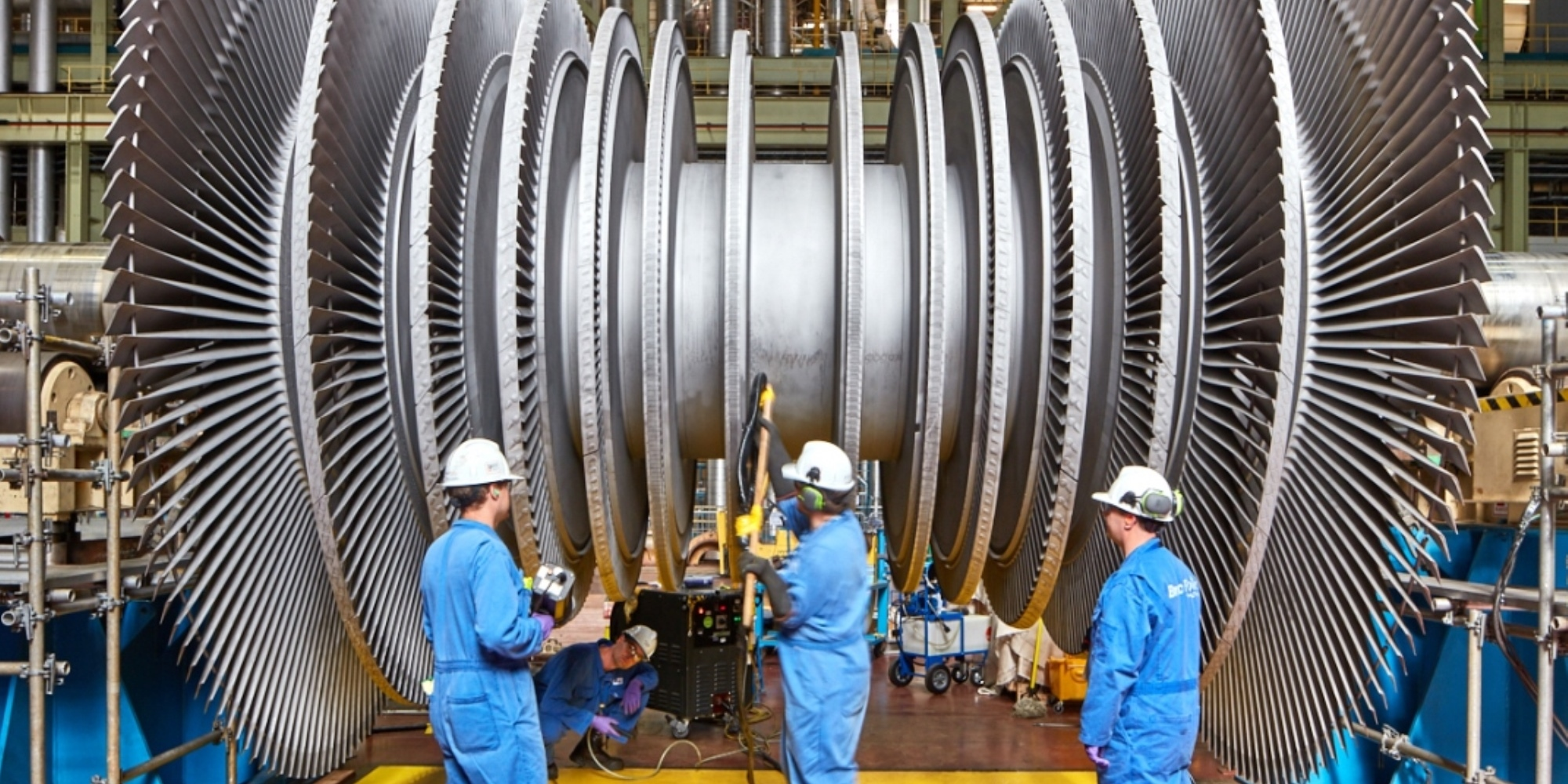 Employees in front of turbine rotor