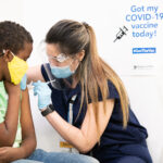 Clinic worker administering vaccine